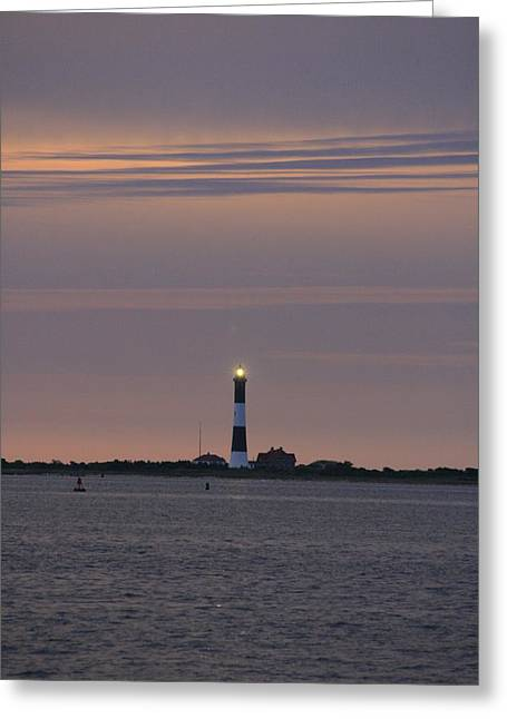Morning Flash Of Fire Island Light Greeting Card by Christopher Kirby