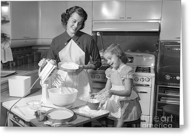 Mother And Daughter Baking A Cake Greeting Card by Debrocke/ClassicStock