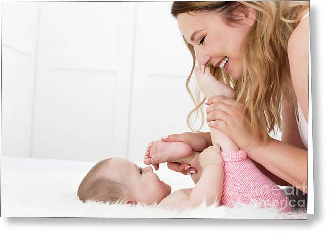 Mother Playing With Her Newborn Baby Daughter. Happy Moments Together. Greeting Card by Michal Bednarek