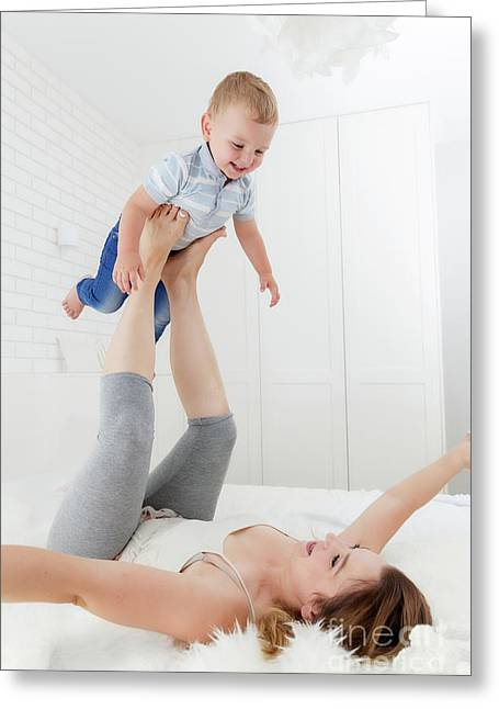 Mother Playing With Her Son. Candid Happy Emotions Of Maternity Love Greeting Card by Michal Bednarek