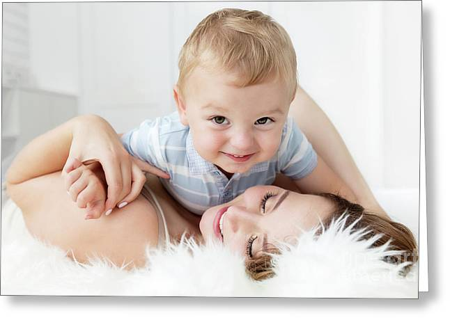 Mother With Her Son. Candid Emotions Of Maternity Love. Greeting Card by Michal Bednarek