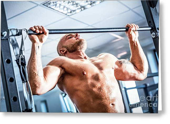 Muscular Strong Man Training At A Gym. Greeting Card