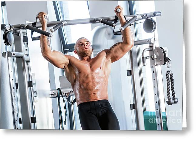 Muscular Strong Man Working Out At A Gym. Greeting Card by Michal Bednarek