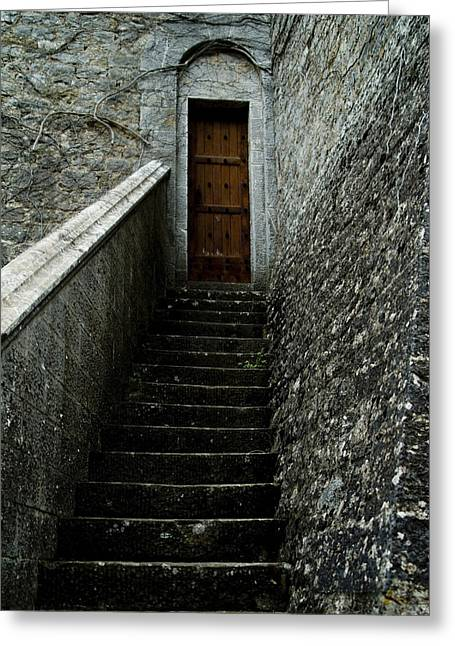 Narrow Stairway To A Wooden Door Greeting Card by Todd Gipstein