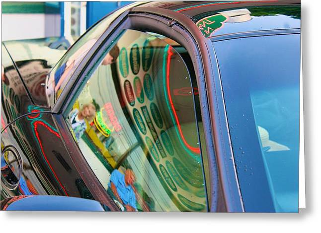 Greeting Card featuring the photograph Neon Reflections On A Black Car by Polly Castor