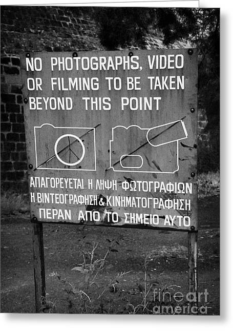 no photography warning sign for restricted area of the UN buffer zone in the green line nicosia Greeting Card by Joe Fox