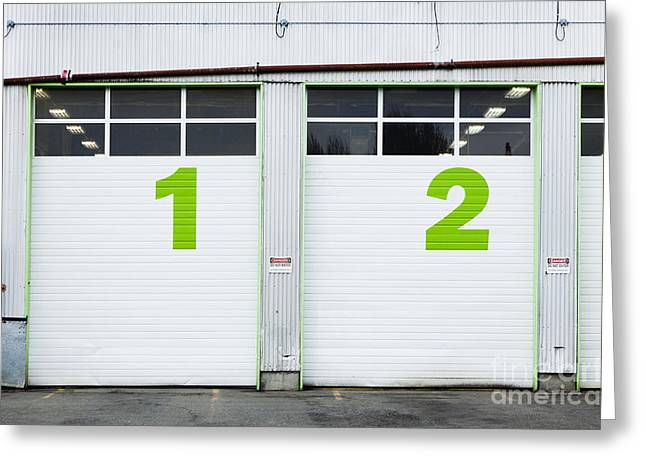 Numbers On Repair Shop Bay Doors Greeting Card by Don Mason
