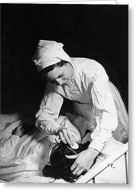 Nurse Tending To A Patient Greeting Card by Underwood Archives