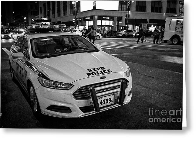 nypd ford fusion police cruiser parked on the street at night New York City USA Greeting Card