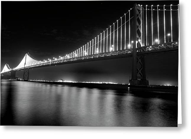 Greeting Card featuring the photograph Oakland Bay Bridge At Night by Darcy Michaelchuk