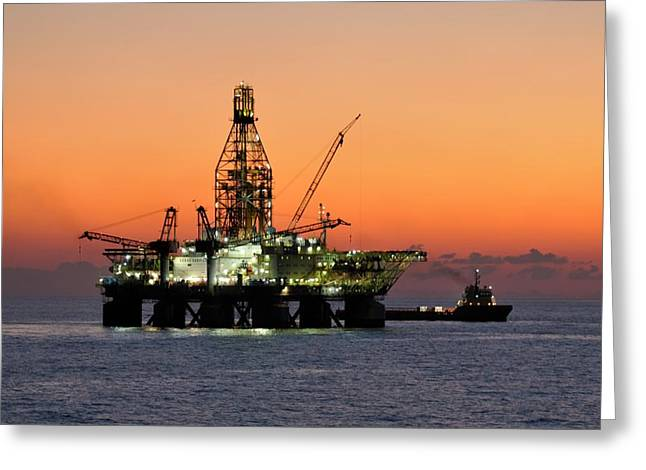 Greeting Card featuring the photograph Oil Rig And Supply Boat After Sundown by Bradford Martin