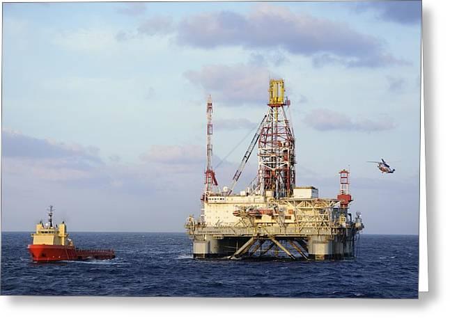 Greeting Card featuring the photograph Oil Rig With Helicopter And Support Vessel by Bradford Martin