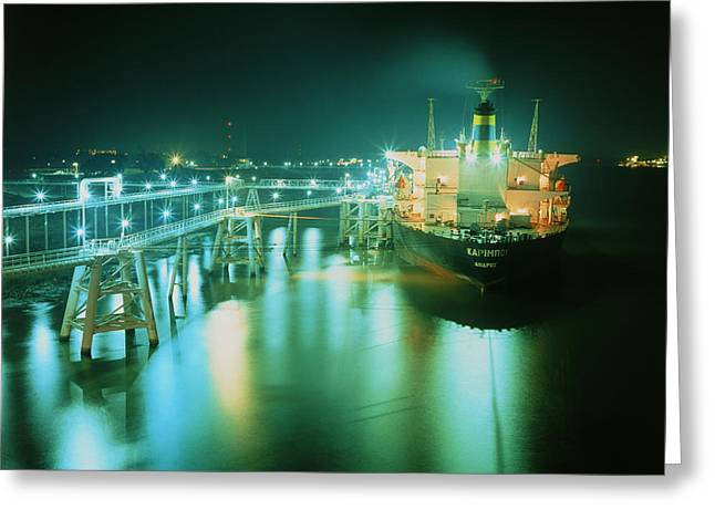 Oil Tanker In Port At Night. Greeting Card by David Parker