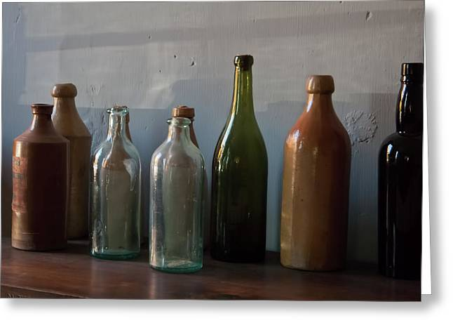 Old Bottles In North Light Greeting Card by Michael Flood