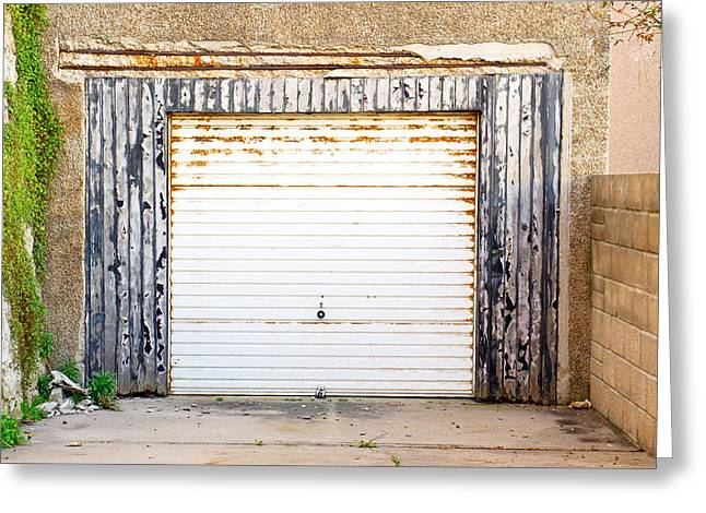 Old Garage Door Greeting Card by Tom Gowanlock