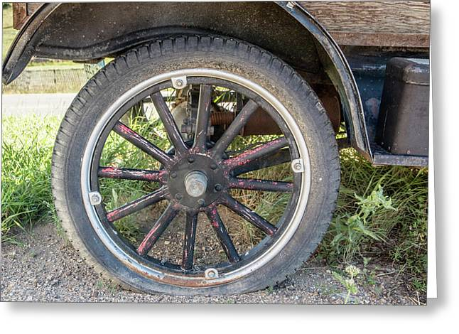 Old Truck Tire In Rural Rocky Mountain Town Greeting Card