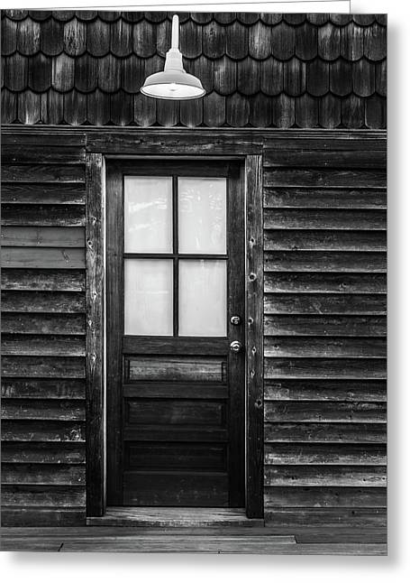 Greeting Card featuring the photograph Old Wood Door And Light Black And White by Terry DeLuco
