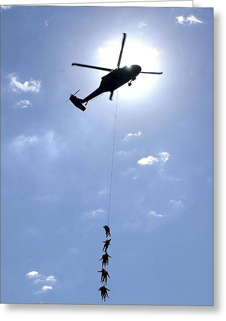Oldiers And Airmen Hang 100 Feet Greeting Card by Stocktrek Images