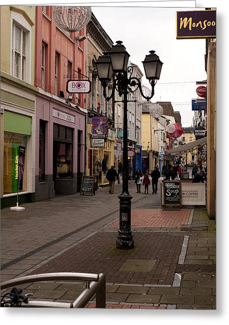 On The Street In Cork Greeting Card by Rae Tucker