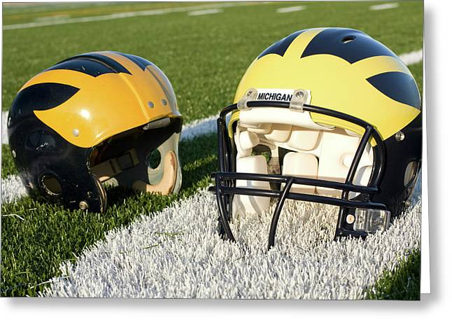 One Old, One New Wolverine Helmets On The Field Greeting Card