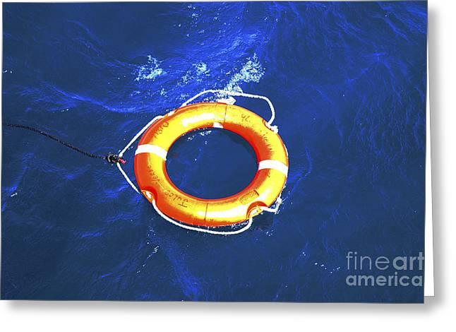 Orange Life Buoy In Blue Water Greeting Card by Jacki Costi