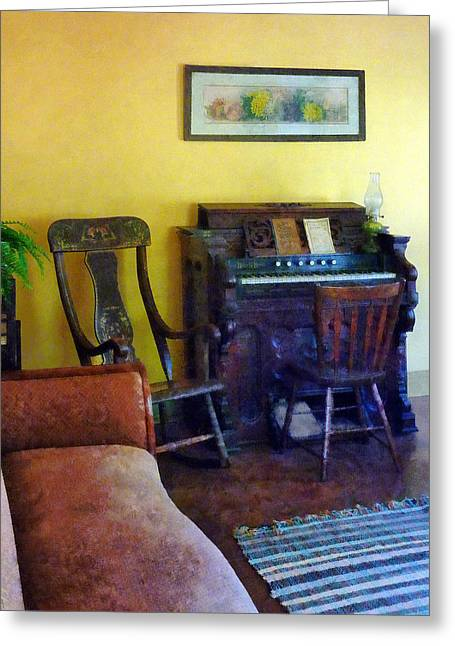 Organ With Hurricane Lamp Greeting Card by Susan Savad