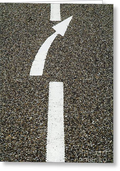 Painted White Arrow Sign In The Dividing Line On The Road Greeting Card