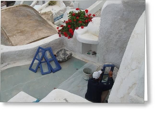 Painting Shutters In Santorini Greece Greeting Card by Nikki Borden