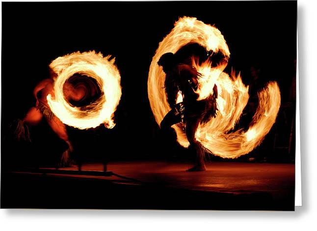 Pair Of Competing Fire Dancers Spinning Lit Batons At Night Afte Greeting Card by Reimar Gaertner