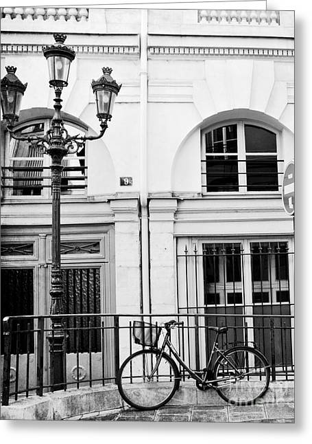 Greeting Card featuring the photograph Paris Black And White Architecture Windows Street Lanterns Bicycle Print - Paris Street Lanterns by Kathy Fornal