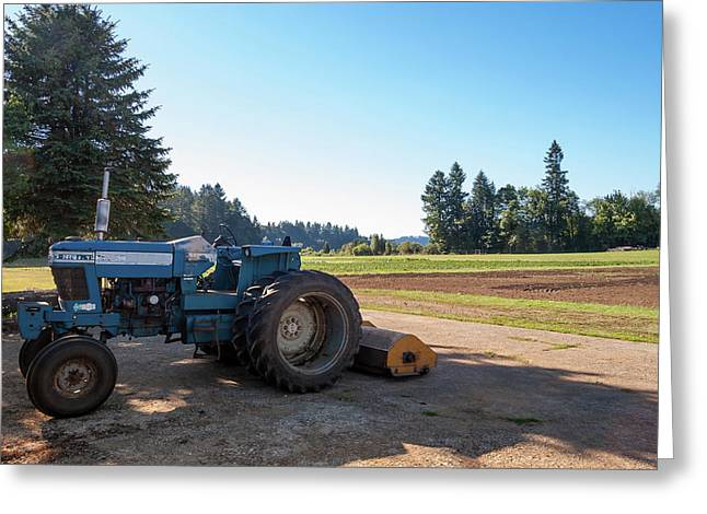 Parked Farm Tractor In Shade After Plowing Field Greeting Card