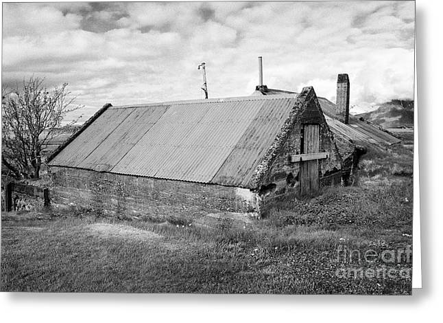 Partially Buried Red Tin Roofed Farm Outbuildings In Southern Iceland Greeting Card by Joe Fox