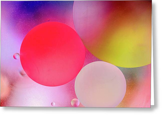 Greeting Card featuring the photograph Pastel Oil Bubble Water Drops by John Williams