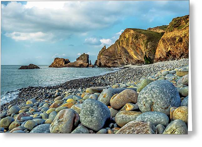 Greeting Card featuring the photograph Pebbles On The Beach by Nick Bywater