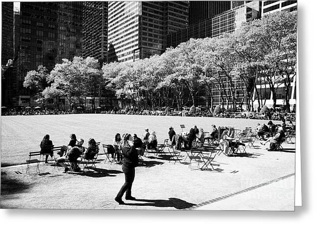 People Eating Lunch Sitting In The Chairs In Bryant Park New York City Usa Greeting Card