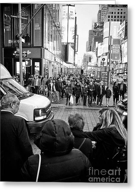 people waiting at crosswalk with full busy sidewalk in the evening evening in Times Square New York  Greeting Card