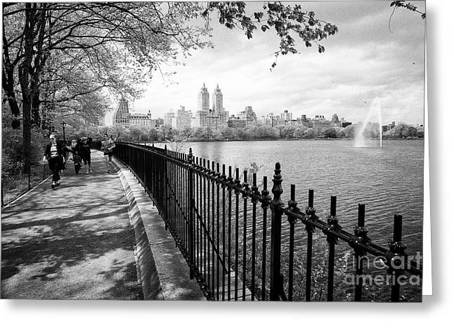 people walking and jogging on cinder track at jacqueline kennedy onassis reservoir central park New  Greeting Card