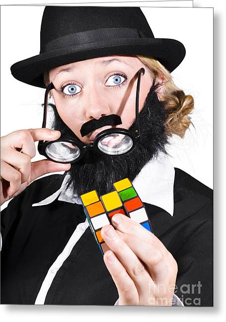 Person Holding Eyeglasses Showing Cube Puzzle Greeting Card by Jorgo Photography - Wall Art Gallery