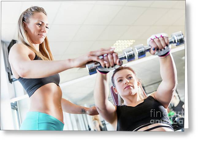 Personal Trainer Assistance During Fatburning Exercise. Greeting Card