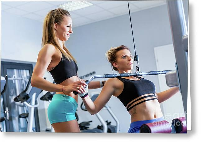 Personal Trainer Assists Client While Workout. Greeting Card