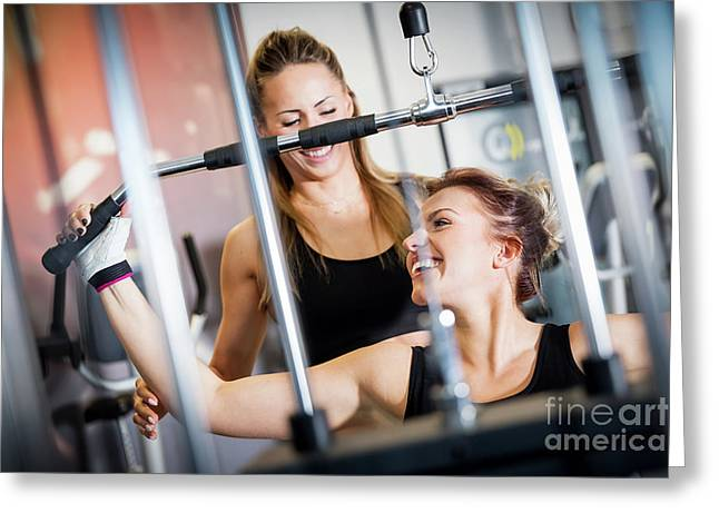 Personal Trainer Helps With Gym Equipment Workout. Greeting Card