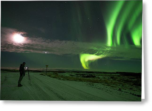 Greeting Card featuring the photograph Photographer Under The Northern Light by Dubi Roman