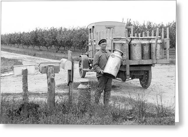 Picking Up Milk Cans Greeting Card by Underwood Archives