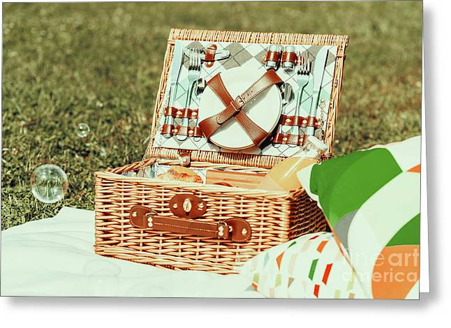 Picnic Basket Food On White Blanket With Pillows And Soap Bubbles Greeting Card by Radu Bercan