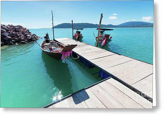 Greeting Card featuring the photograph Pier At Khanom by Atiketta Sangasaeng