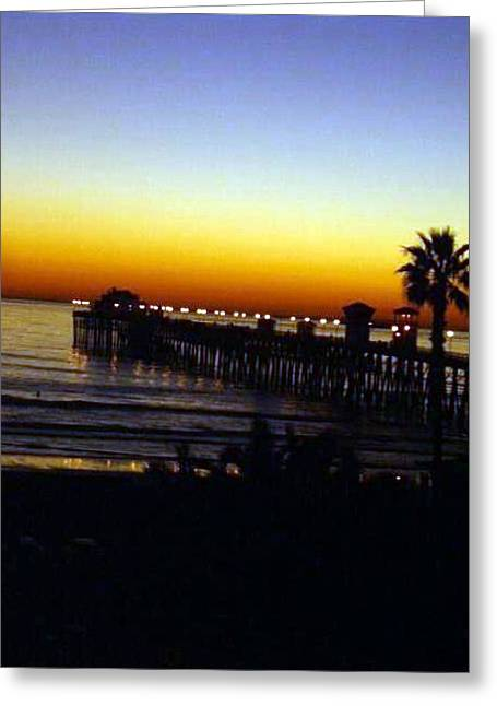 Greeting Card featuring the photograph Pier At Sunset by Amanda Eberly-Kudamik
