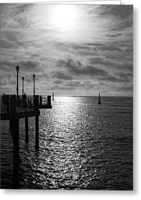 Greeting Card featuring the photograph Pier Into The Sun by Michael Hope