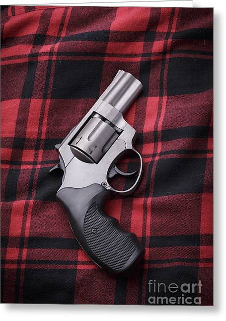 Pistol On A Red Flannel Shirt Greeting Card by Edward Fielding