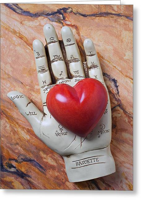 Plam Reader Hand Holding Red Stone Heart Greeting Card by Garry Gay