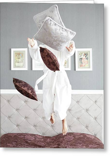 Playful Young Woman Jumping On The Bed , A Pillow Fight Greeting Card by Jan Pavlovski